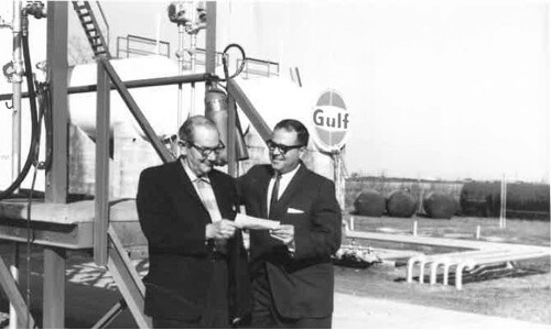 J Dudley Guillory 2nd generation owner on left with Gulf representative